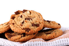 Milk chocolate chip cookies isolated on linen napkin on white background Royalty Free Stock Photo