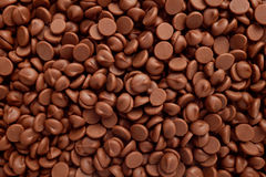 Milk chocolate chips background Royalty Free Stock Image