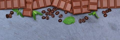 Milk chocolate chocolates bar food slate banner copyspace top vi Stock Photo