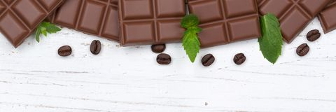 Milk chocolate chocolates bar food wooden board copyspace top vi Stock Photography