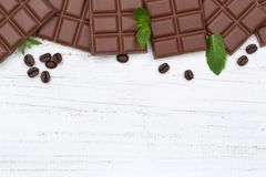Milk chocolate chocolates bar food wooden board copyspace top vi Royalty Free Stock Images
