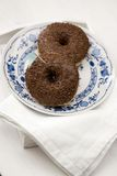 Milk chocolate donuts. On blue plate royalty free stock photo