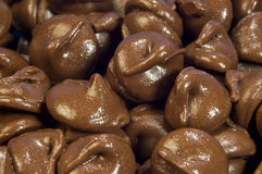 Milk chocolate drops Stock Photo