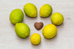 Milk chocolate heart-shaped with seven limes Stock Photos