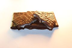 Milk chocolate patties with a mint filling inside it. Mint inside the chocolate squares. popular around christmas time, but delicious anytime of the year Stock Images