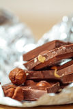 Milk chocolate pieces with nuts Stock Images