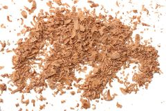 Milk chocolate shavings isolated on white background top view Royalty Free Stock Photo