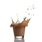 Milk chocolate splash isolated over white background.  Stock Photo