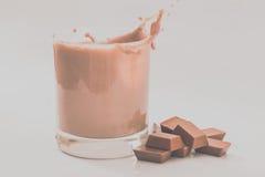 Milk chocolate. Splash with white background Royalty Free Stock Photos