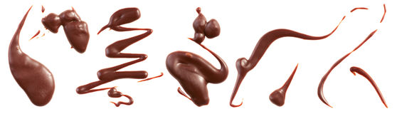 Milk chocolate splashes Stock Photos