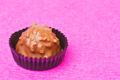 Milk chocolate sweet with hazelnut flakes Stock Photos