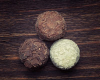 Milk chocolate,white chocolate and dark chocolate truffles Stock Images
