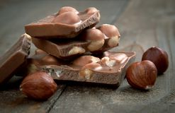 Milk chocolate with hazelnuts Stock Photography