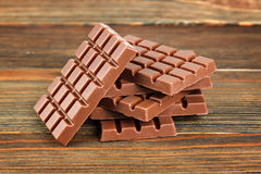 Milk chocolate on wood Stock Photography