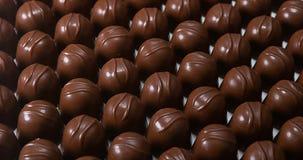 Milk Chocolates turning,. Slow motion 4K stock video footage
