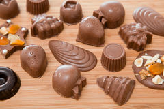 Milk chocolates on wood Stock Image