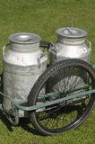 Milk churns at the farm Stock Photos