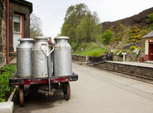 Milk churns in old railway station Stock Photography