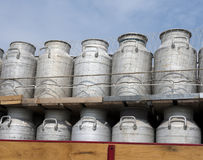 Milk churns on old truck against blue sky background Royalty Free Stock Photography