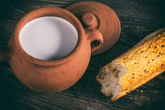 Milk in clay pot Royalty Free Stock Images