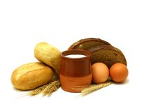 Milk in clay pot, buns, bread and eggs isolated on Stock Photo
