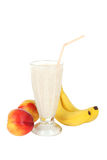 Milk cocktail with banana in a glass isolated on white Royalty Free Stock Photography
