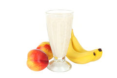 Milk cocktail with banana in a glass isolated on white. Royalty Free Stock Photography
