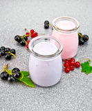 Milk cocktail with black and red currant on granite table Royalty Free Stock Photo