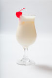 Milk cocktail with a cherry in a tall glass Stock Photography