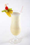 Milk cocktail with pineapple and carom. On a white background Stock Photos