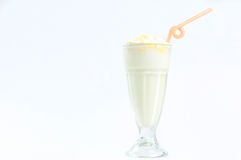 Milk cocktail in a tall glass with a straw. Isolated Royalty Free Stock Photos