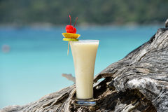 Milk cocktail on wood at beach Royalty Free Stock Image