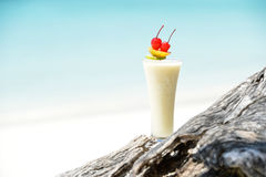 Milk cocktail on wood at beach Stock Photography