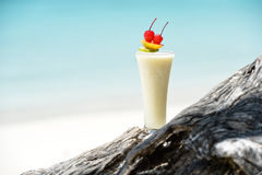 Milk cocktail on wood at beach Stock Images