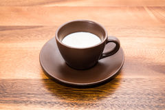 Milk in coffee cup on wood backgrounds Royalty Free Stock Photo