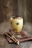Milk with coffee ice cubes. Royalty Free Stock Photography