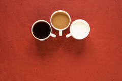 Milk and coffee on red Royalty Free Stock Images