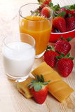 Milk and coffee and strawberries. Fruit juice milk and coffee with frgole and afternoon snack on wood of fir Stock Photo