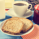 Milk, coffee, toasts and jam, cross-processed Stock Image