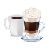 Milk coffee with whipped cream and coffee cup Royalty Free Stock Images