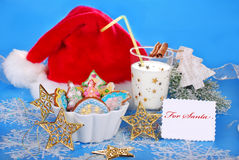 Milk and colorful gingerbread cookies for santa Royalty Free Stock Photos