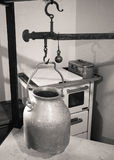Milk container is weighed in an old hut. Royalty Free Stock Photo