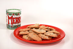 Milk and cookies. Chocolate chip cookies and a glass of cold milk in a Christmas glass Stock Image