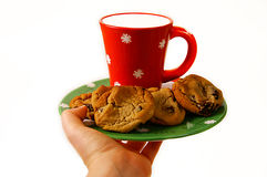 Milk and cookies. Serving a plate of cookies and milk royalty free stock photography