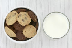 Milk and Cookies. Top view of a bowl of cookies and a glass of milk Stock Image