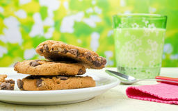 Milk and Cookies. A plate of chocolate chip cookies and glass of milk on a windowsill Royalty Free Stock Photography