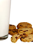 Milk and Cookies. Glass of milk with delicious chocolate chip cookies Royalty Free Stock Images