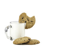 Milk and cookies with bite Royalty Free Stock Photography