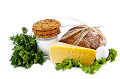 Milk, cookies, bread, cheese, egg, salad and ears. Stock Photo
