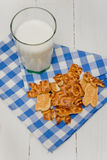 Milk and cookies on  checkered napkin Stock Image
